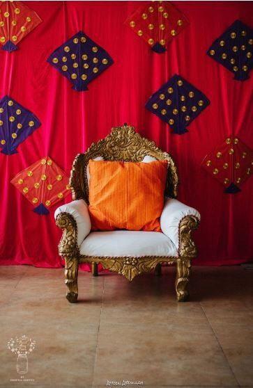 Photo of Mehndi photobooth idea with kites and sofa