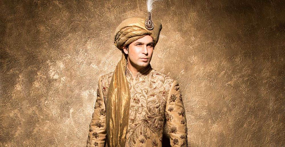 Photo of Gold embroidered sherwani with beige safa