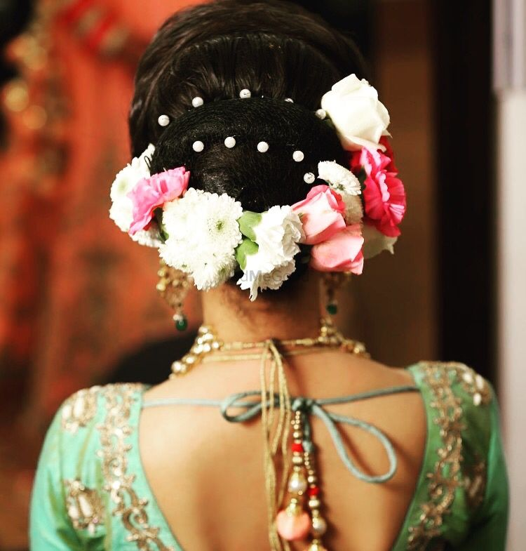 Photo of Engagement hairstyle with different flowers