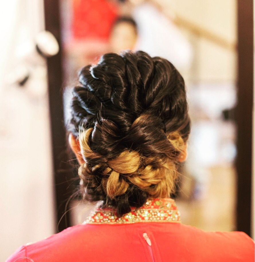 Photo of Twisted knotted bun for sangeet or reception