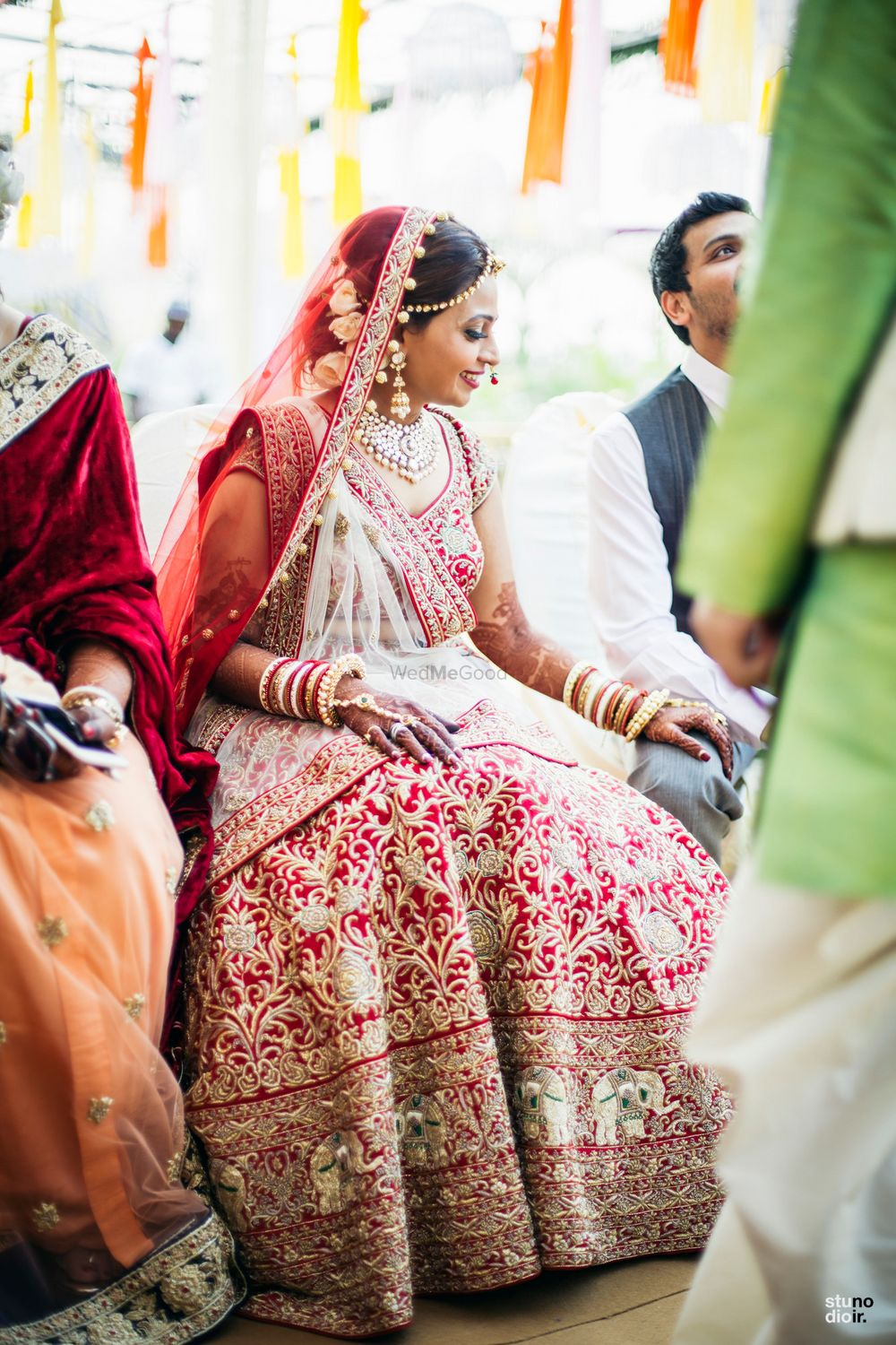 Photo of Red and gold bridal lehenga with elephant embroidered motif