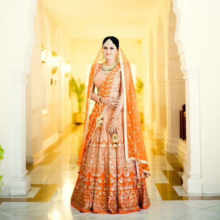 Photo of Orange and gold bridal lehenga offbeat