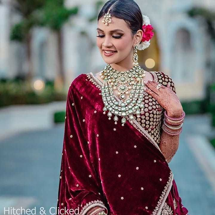 Photo of Winter bride in velvet with layered bridal jewellery