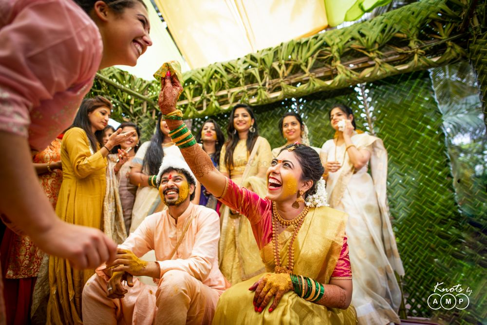 Photo of fun haldi couple portrait!