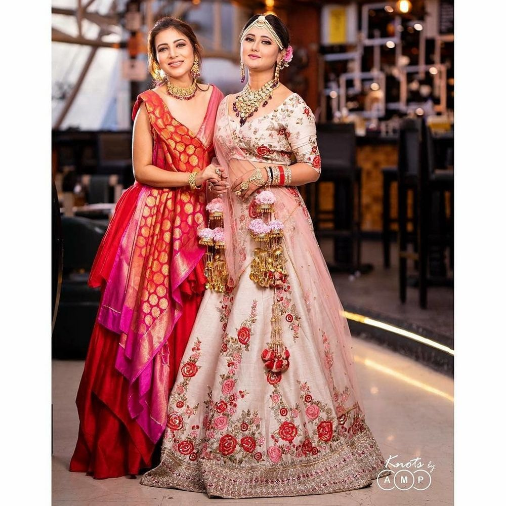 Photo of Bride and bridesmaid in absolute stunning outfits and jewellery.