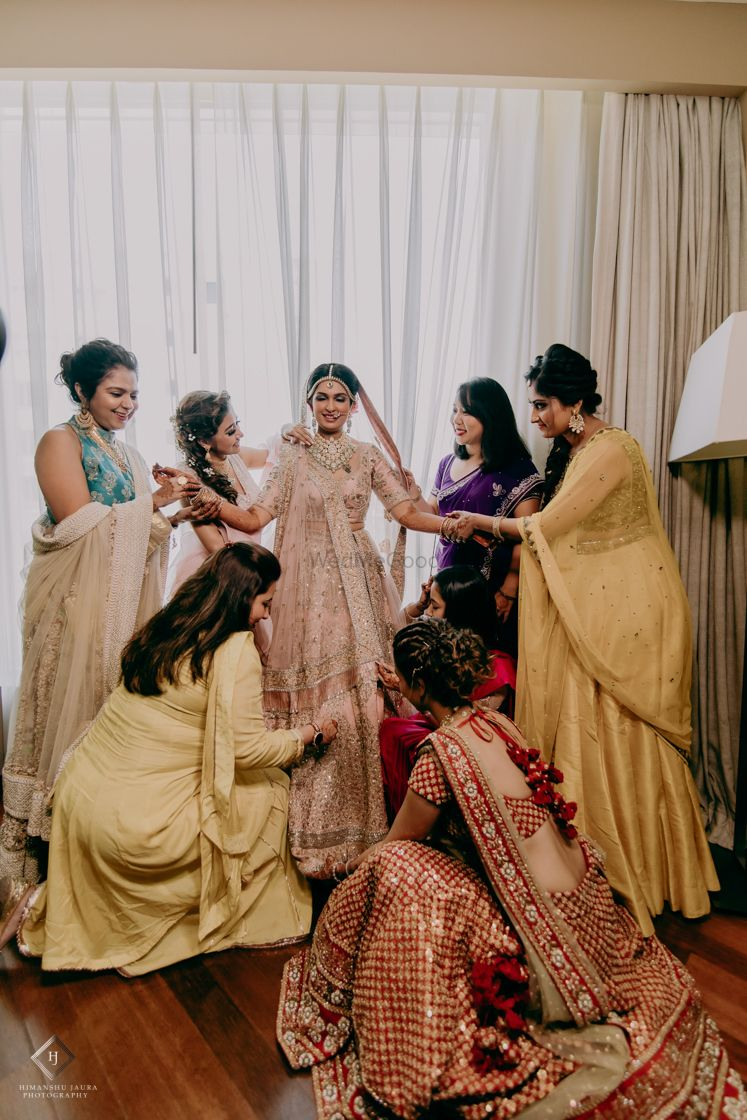 Photo of A bride has the complete army of her bridesmaids.