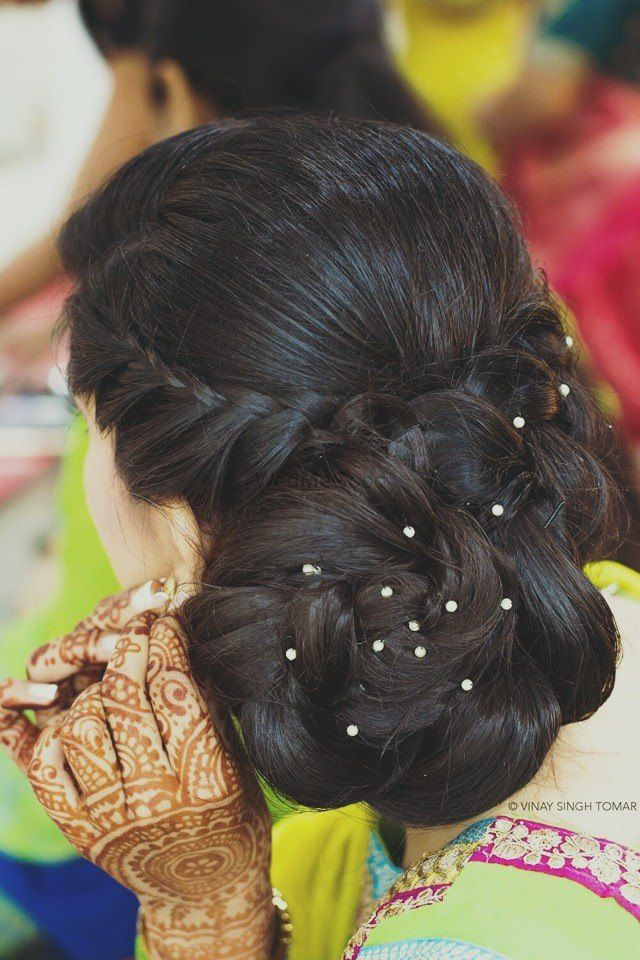 Photo of braided bun hairstyle diamond crystals in hairdo