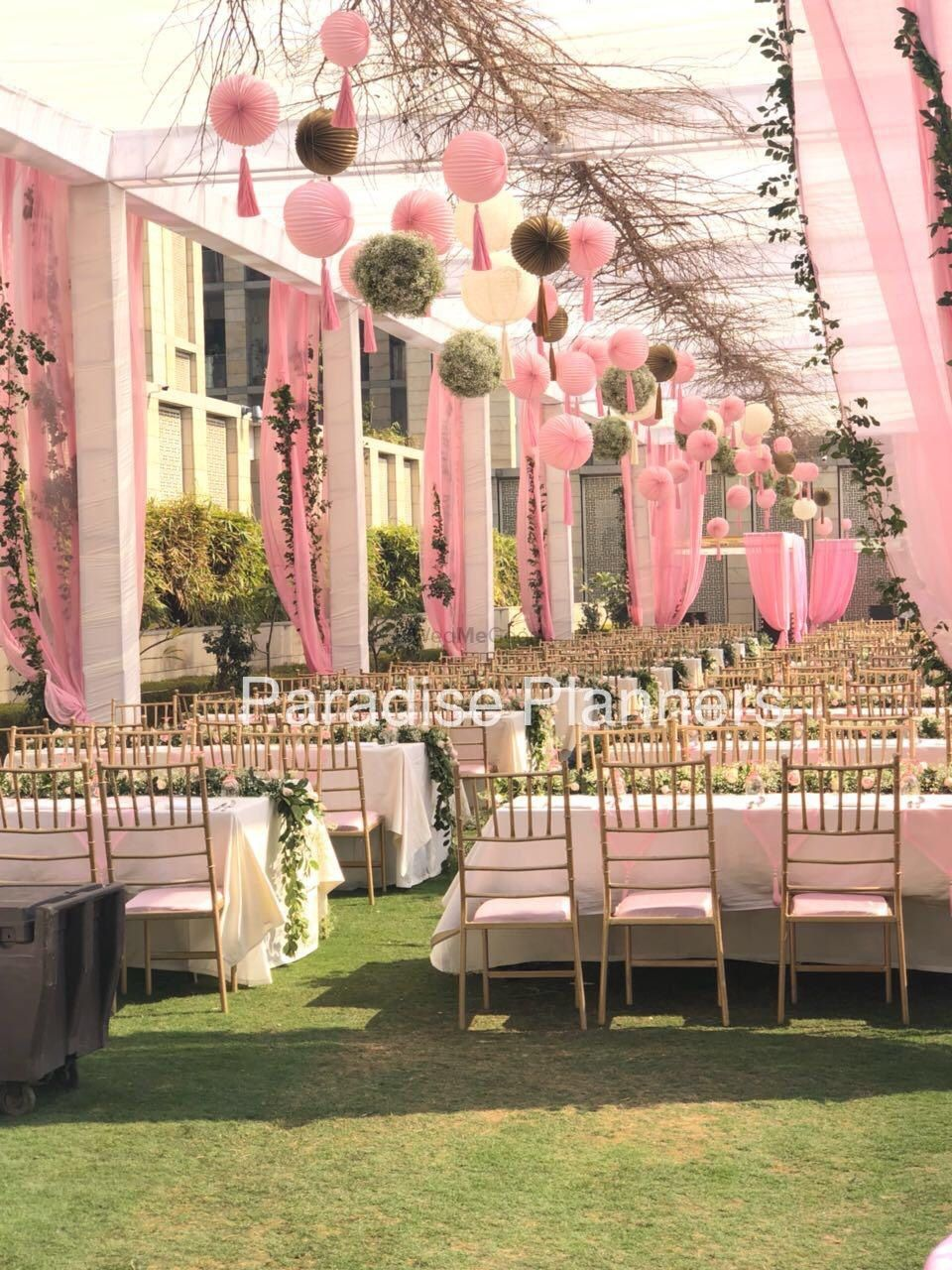 Photo of A modern styled table setting with white and pink decor theme.