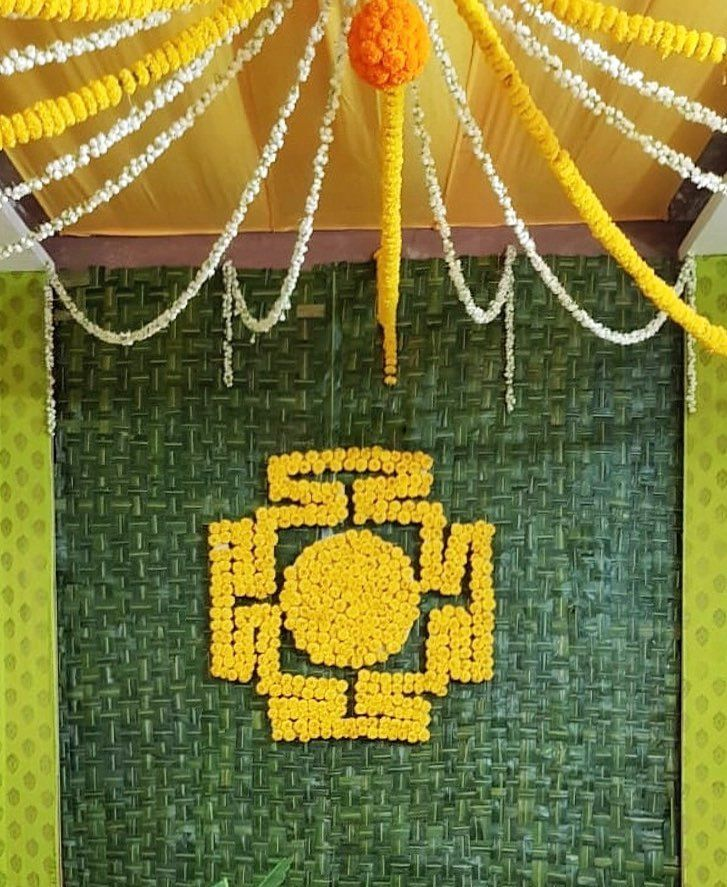 Photo of Stunning South Indian wedding floral decor with orange and yellow genda flowers