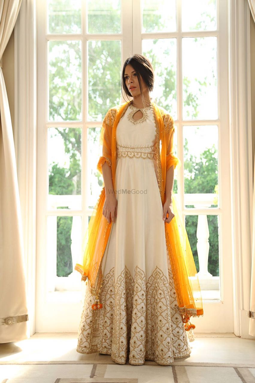 Photo of white and yellow anarkali