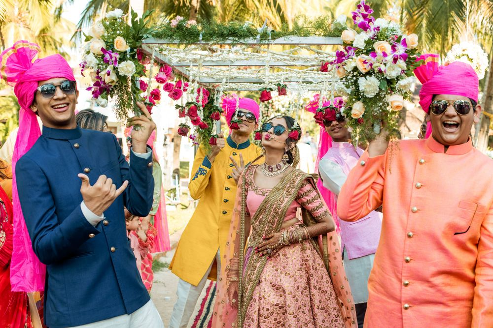 Photo of Bride entering with brothers cool