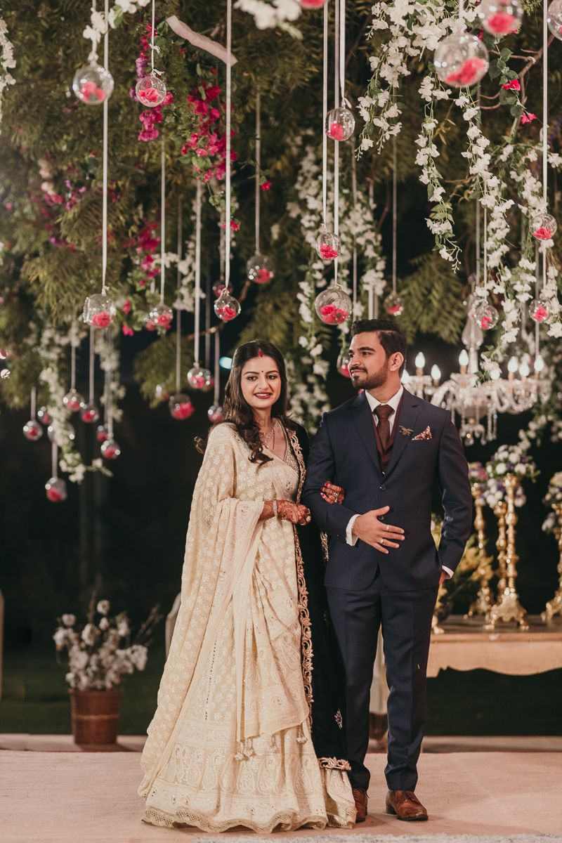 Photo of engagement decor with suspended florals and orbs