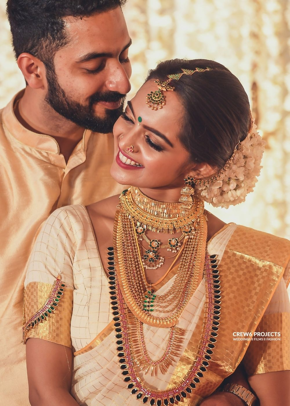Photo of Matching bride and groom South Indian couple