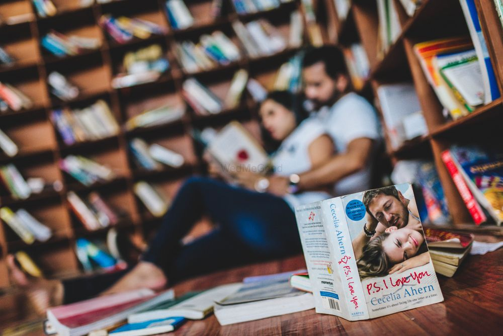 Photo of Library pre wedding shoot idea with books