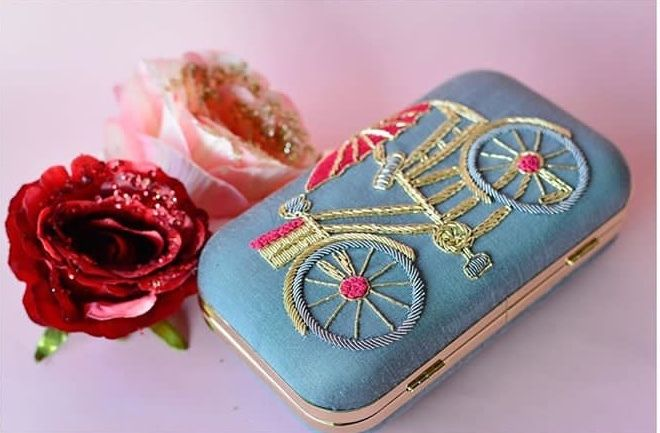 Photo of Pretty bicycle clutch for sangeet or mehendi function