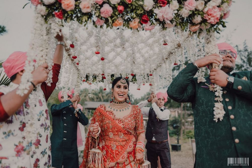 Photo of Bridal entry under a phoolon ki chaadar