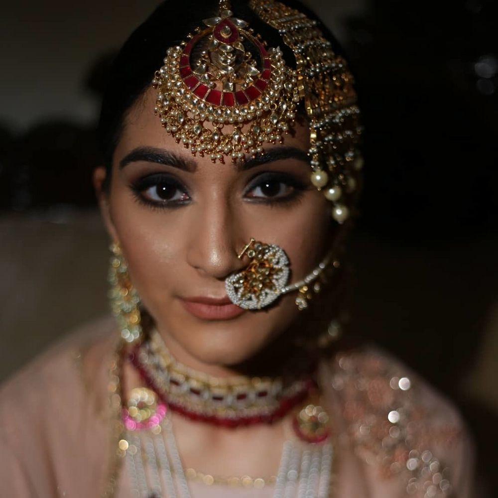 Photo of Unique bridal jewellery with Nath and jhoomer