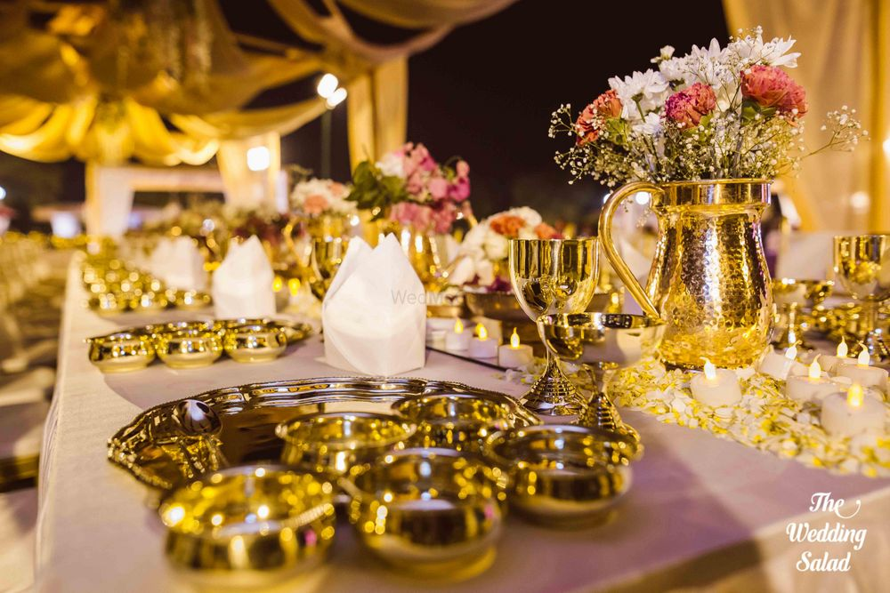 Photo of Gold jugs with flowers in table decor