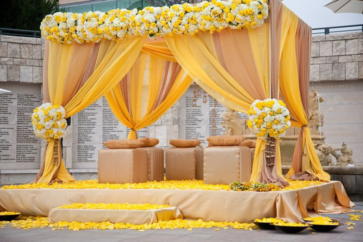 Photo of A yellow floral mandap decor