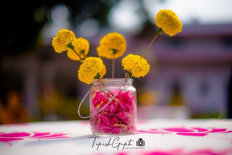 Photo of Floral centrepiece with marigolds and rose petals
