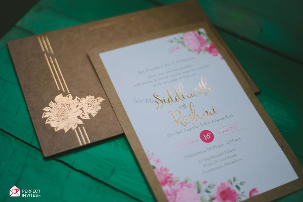 Photo of Floral and brown paper themed wedding invites