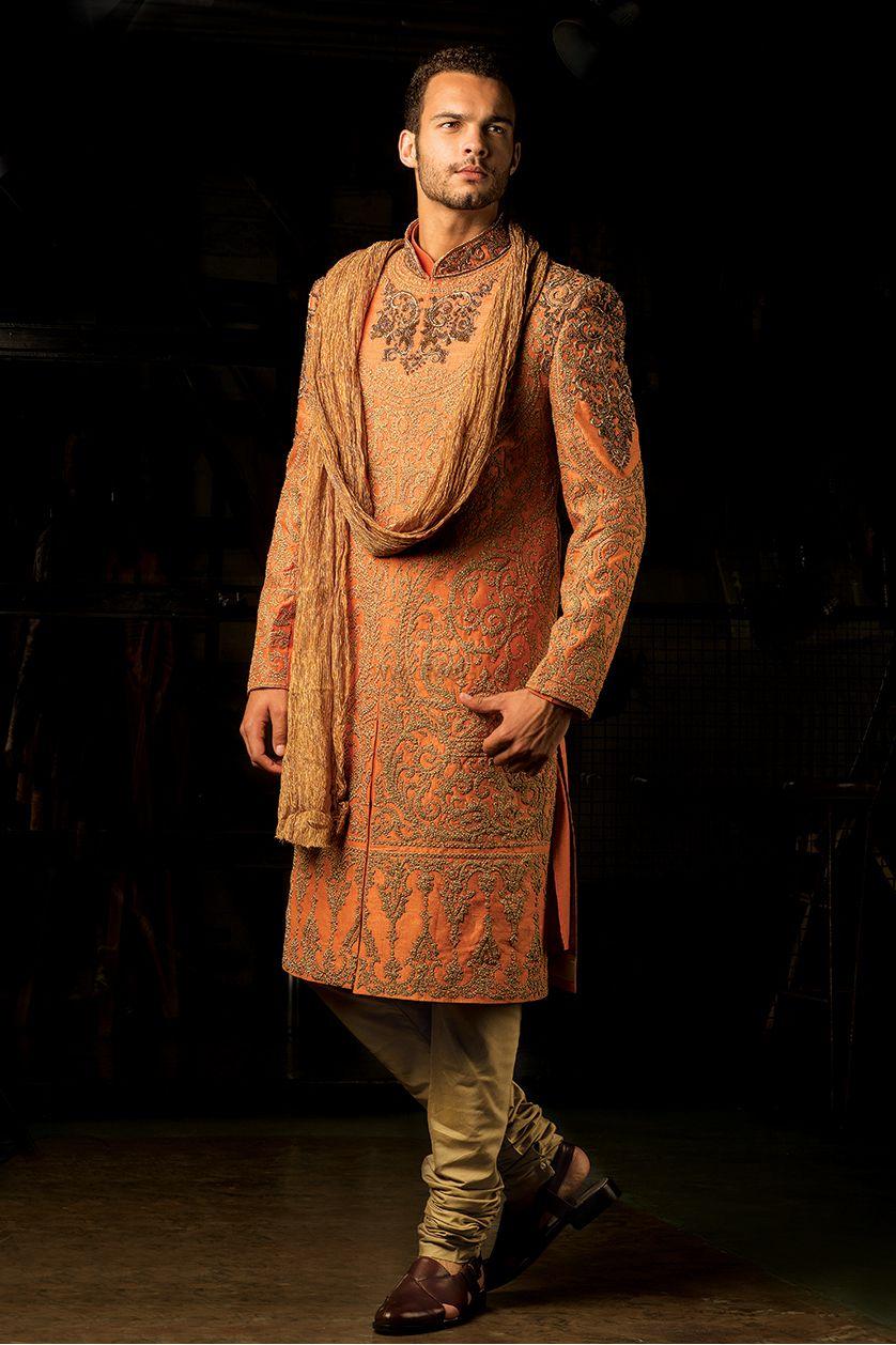 Photo of Orange embroidered sherwani for groom