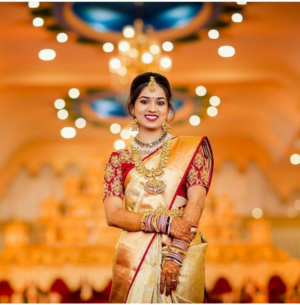 Photo of South Indian blouse design contrasting with gold saree