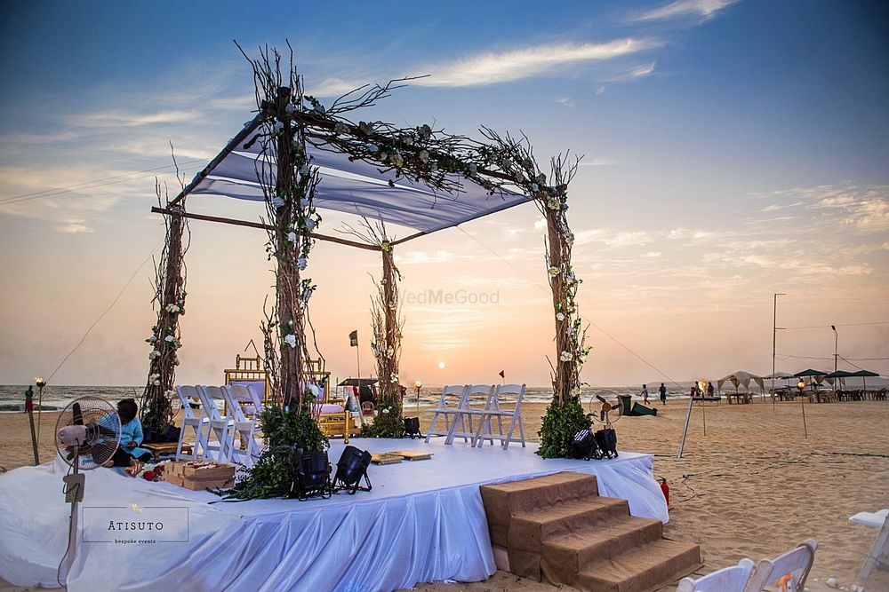 Photo of Simple mandap for beach wedding with twigs and greens