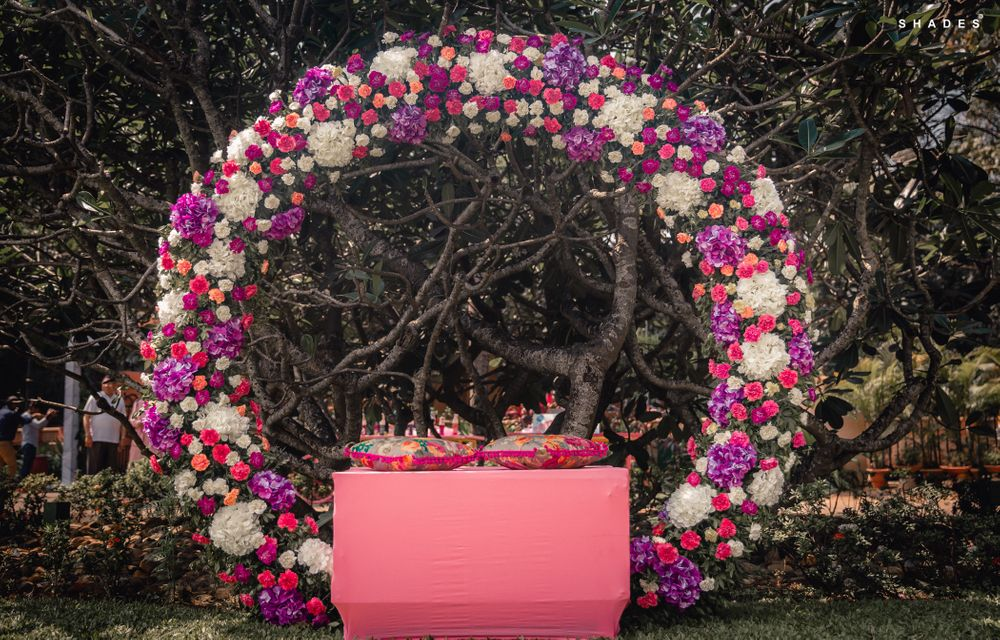 Photo of Giant floral wreath as mehendi or engagement photobooth
