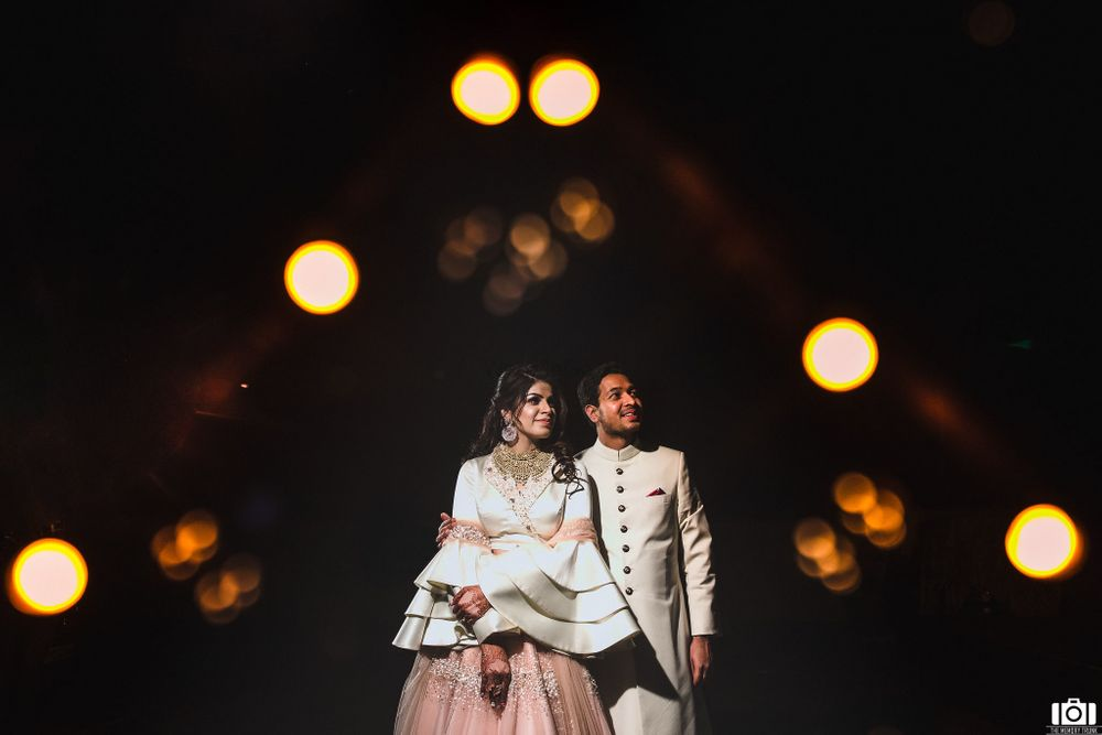 Photo of A royal couple portrait shot with the bride in bell sleeves!
