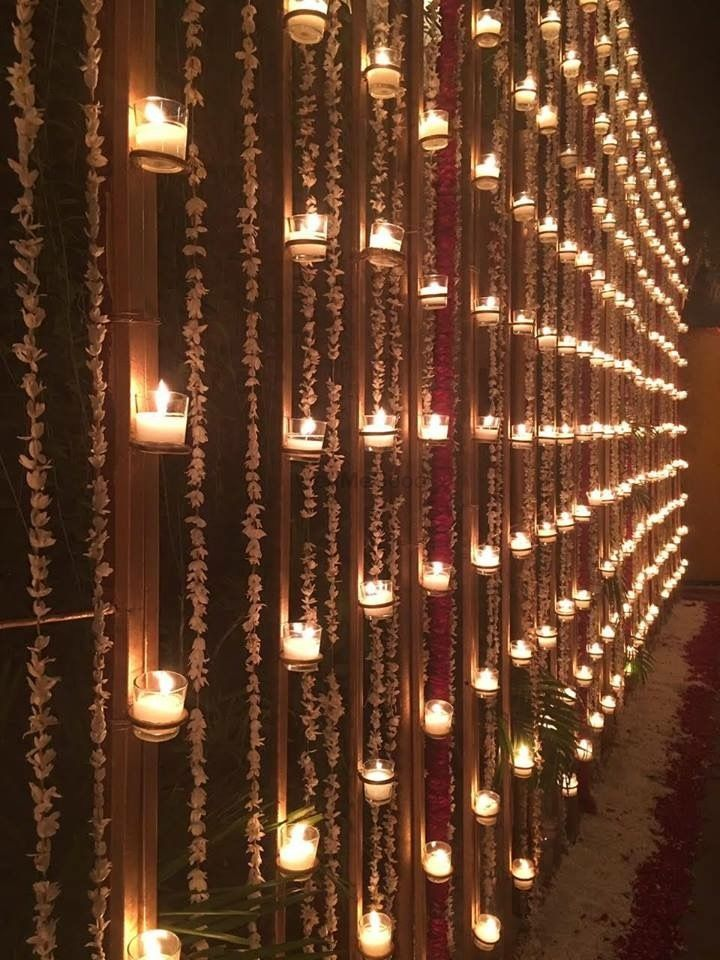 Photo of Wall with candles and floral nighttime decor