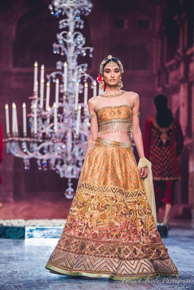 Photo of Tahiliani Mustard Yellow and Pink Thread Work Lehenga