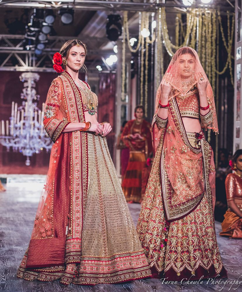 Photo of Maroon and Gold Light Lehengas with Intricate Work