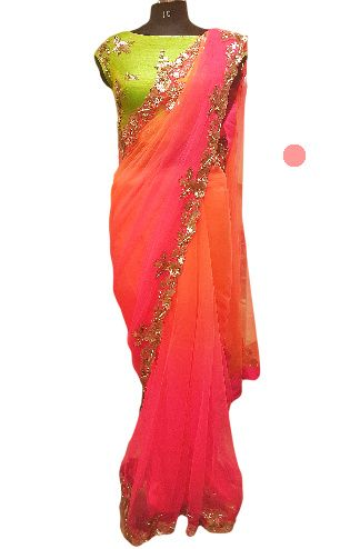 Photo of lime green and ombre pink and orange georgette saree with scalloped silver embroidery border. crop top blouse. friend of the bride