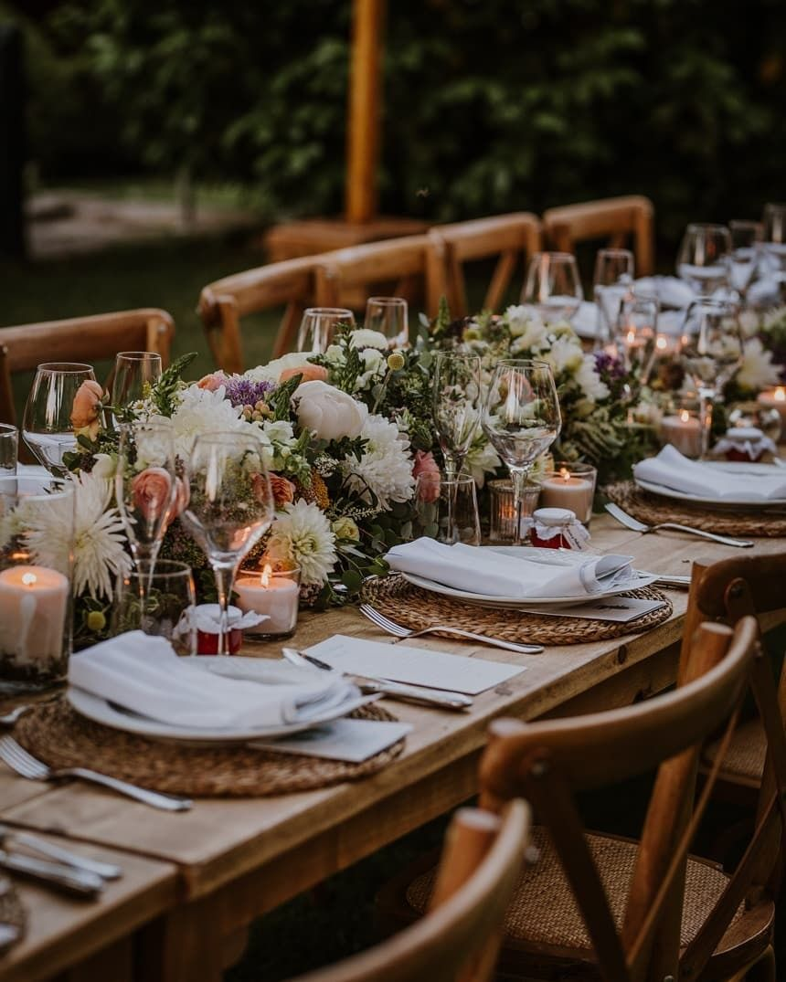 Photo of Floral decor with rustic touches for the table settings.