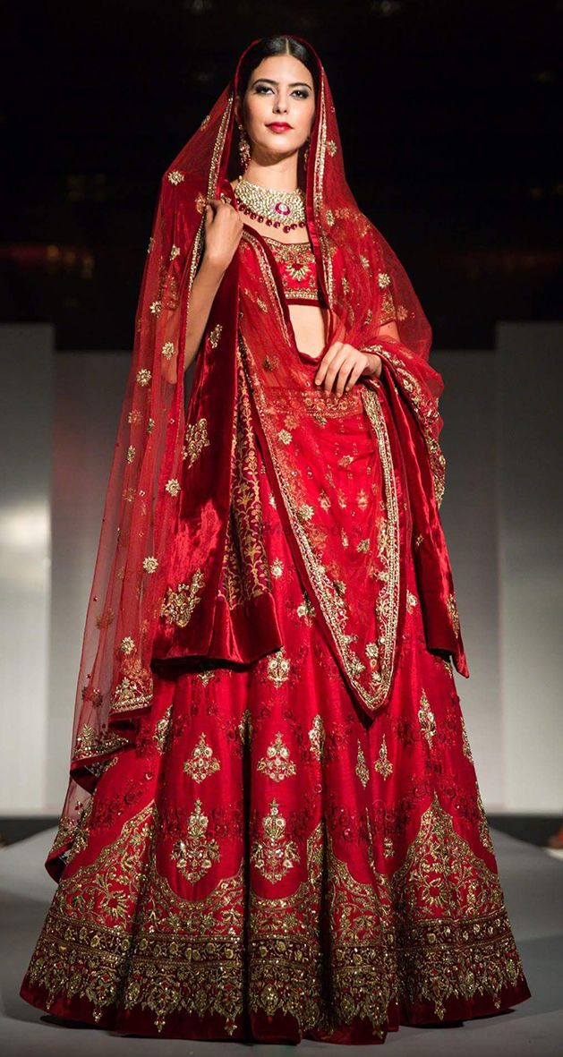 Photo of Bright red bridal lehenga with silver motifs