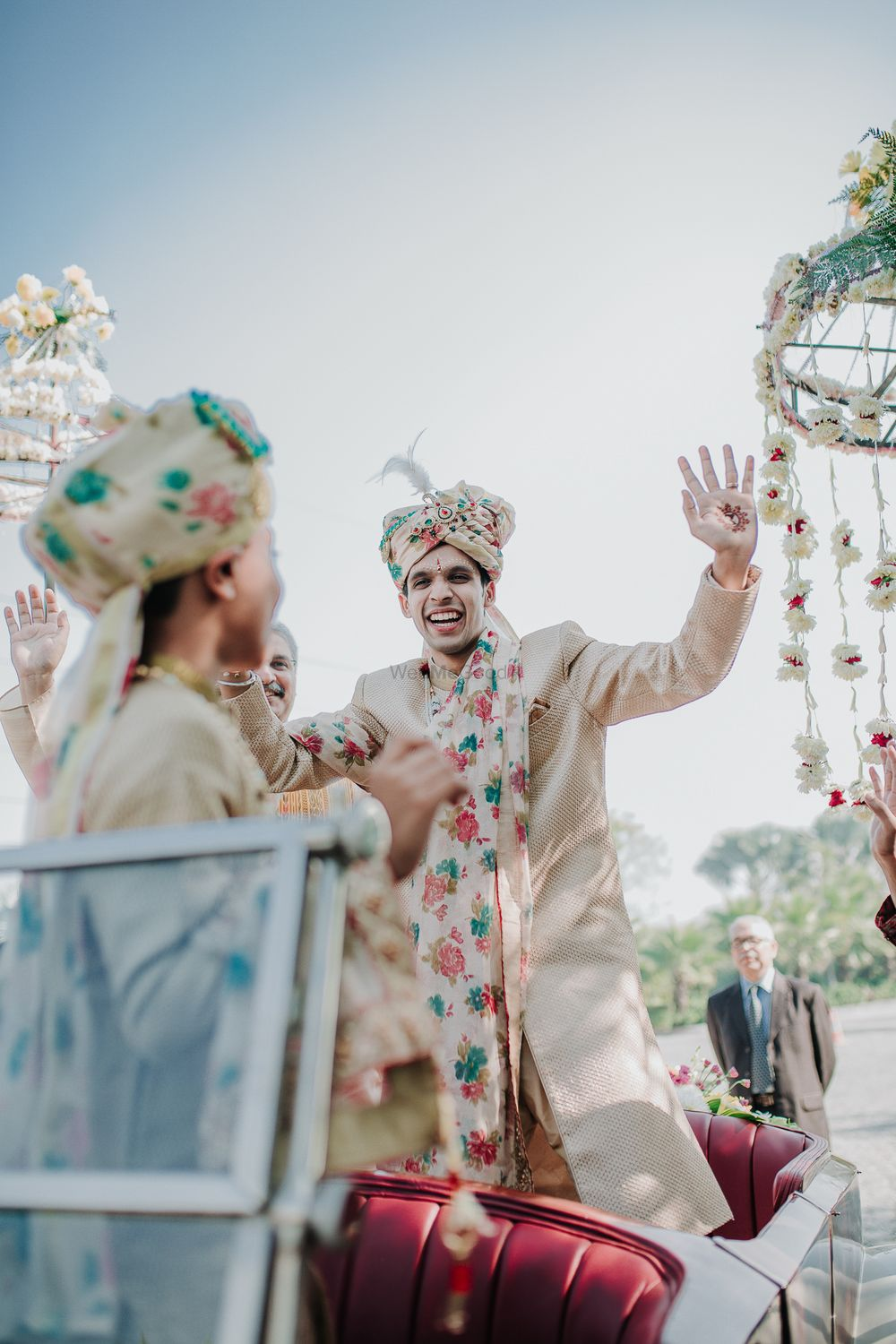 Photo of Groom entry idea wearing floral safa