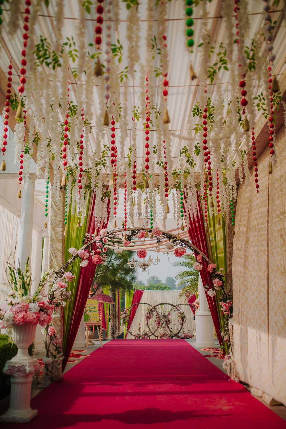 Photo of Decor for entranceway with hanging floral strings