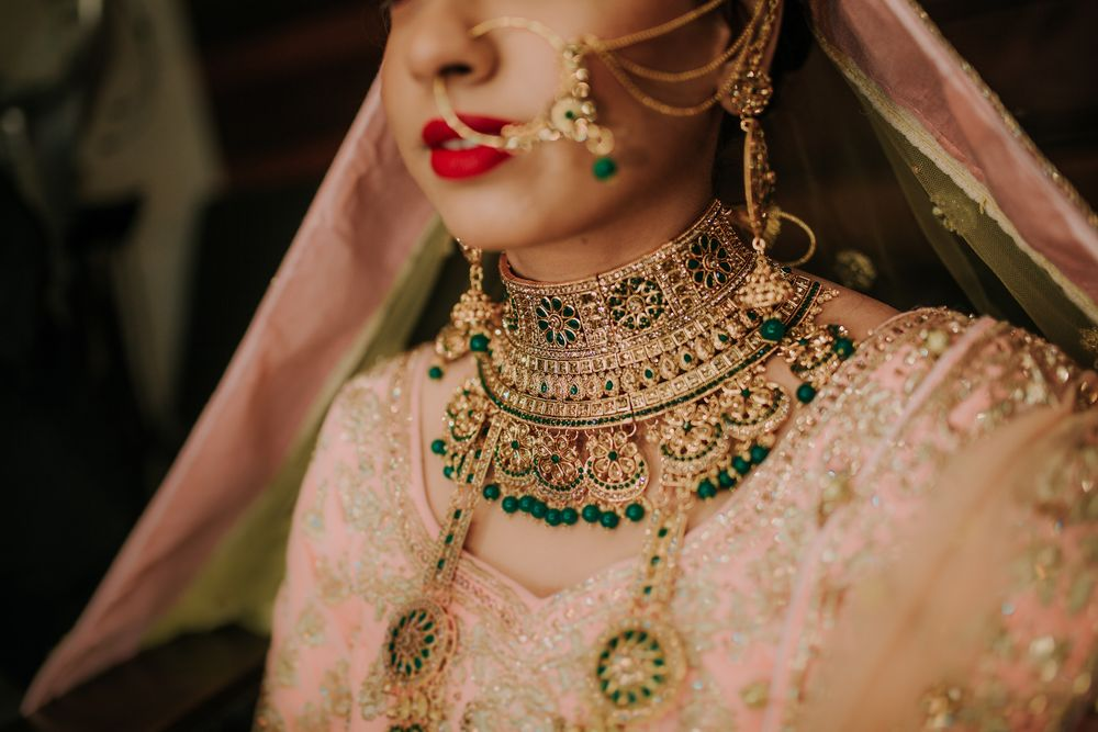 Photo of Bridal choker with green with a pastel lehenga