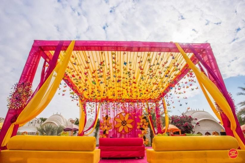 Photo of Pink and yellow mehendi decor theme with hangings