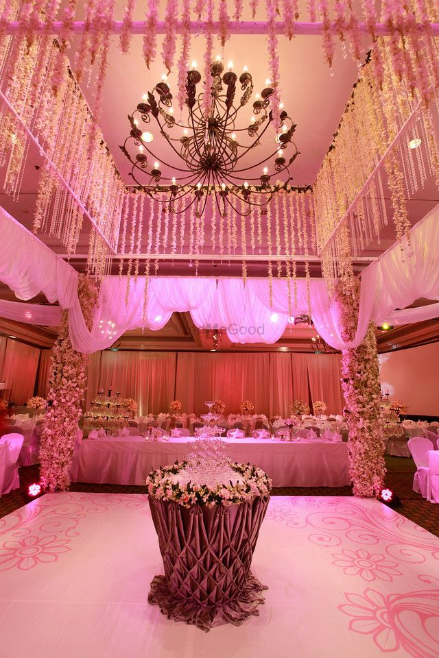 Photo of Light pink themed floral arrangement and chandelier