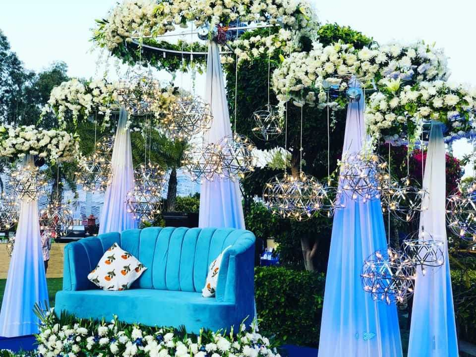 Photo of Alluring sangeet decor idea with flowers, curtains and lights.