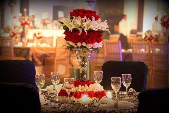 Photo of Red and white theme table decor for Cocktail/ Sangeet