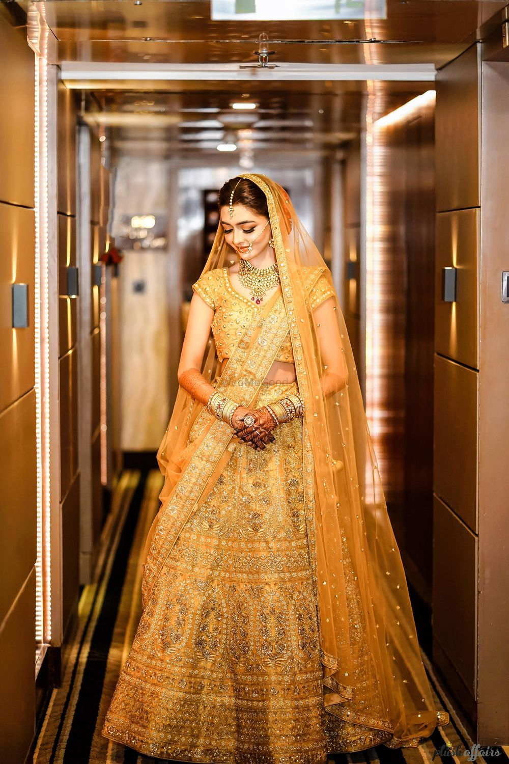Photo of A bride in a gold lehenga
