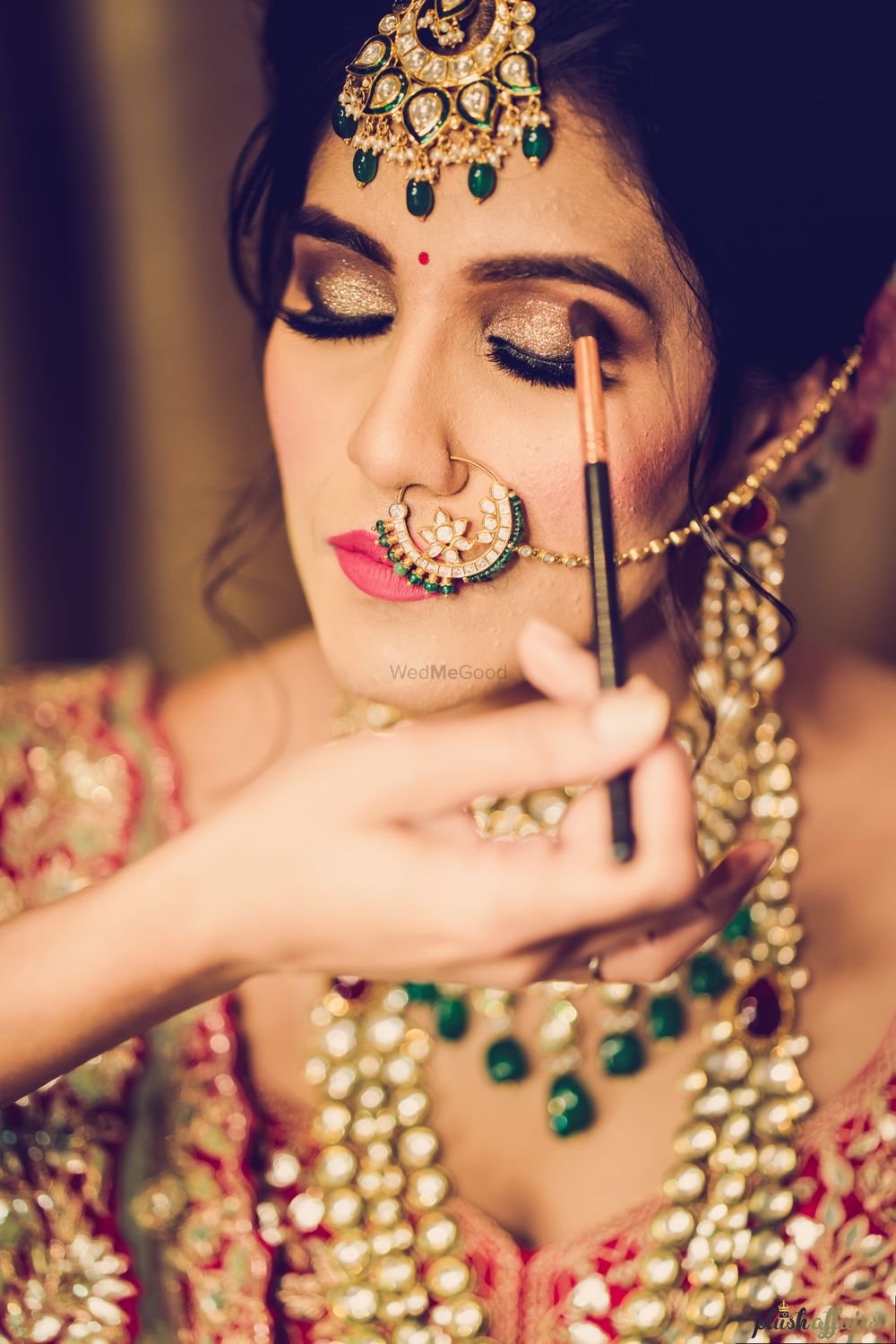 Photo of A bride getting her makeup done
