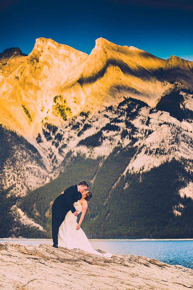 Photo of Christian couple kissing portrait with hilly backdrop