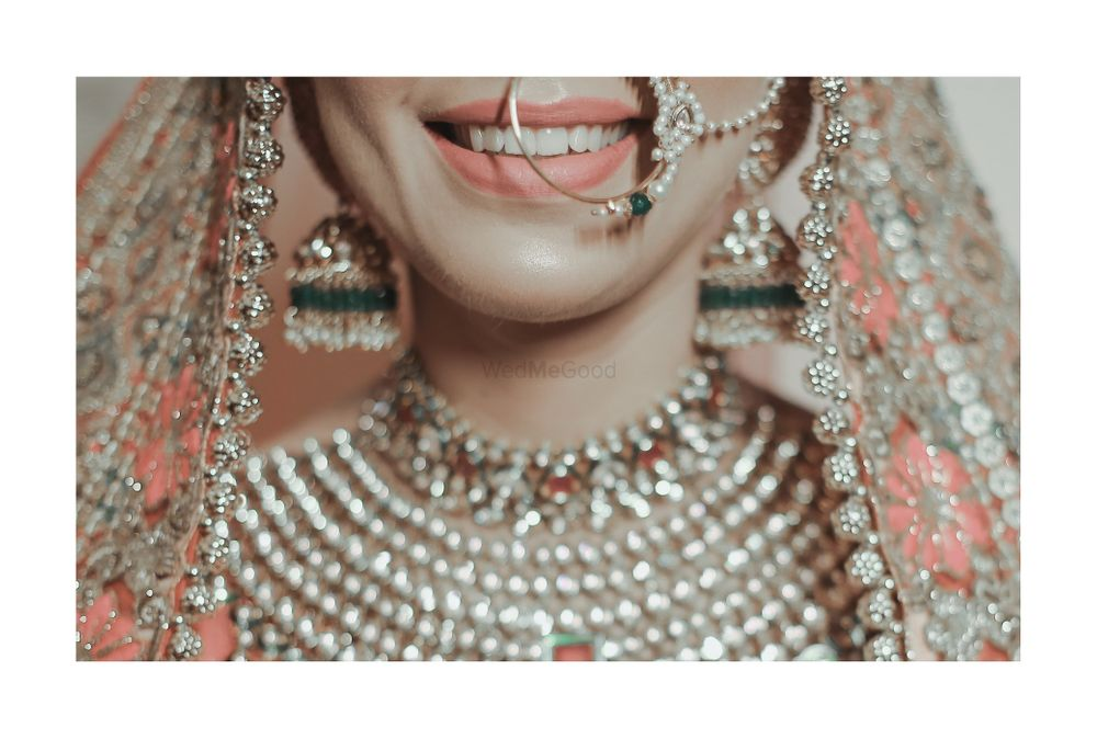 Photo of A close-up shot of bride smiling so wide on her wedding day