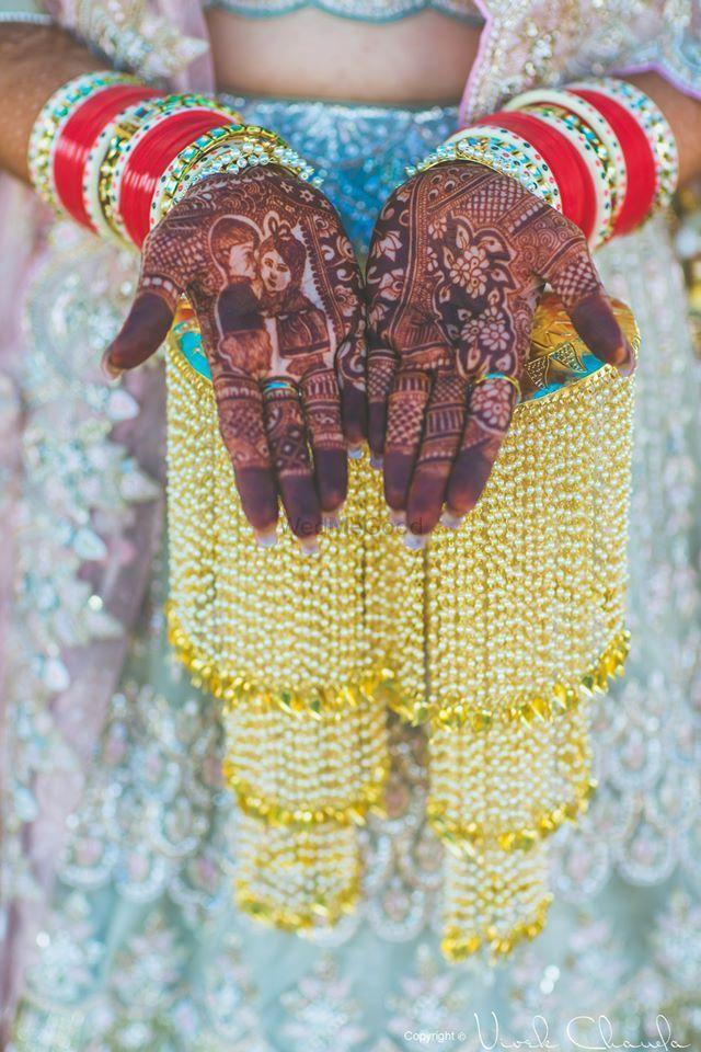 Photo of bride wearing heavy kaleere