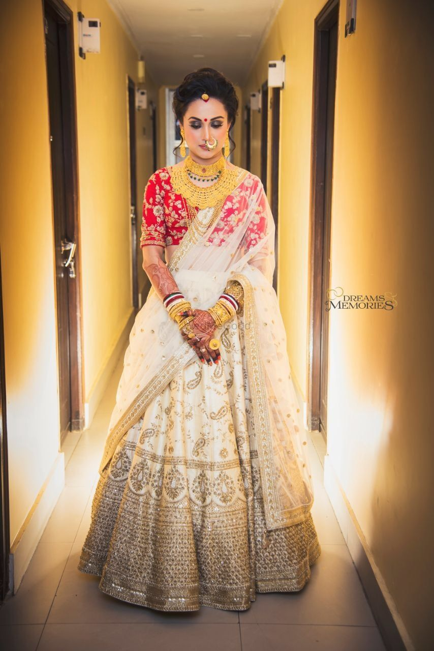 Photo of Off white bridal lehenga with red blouse