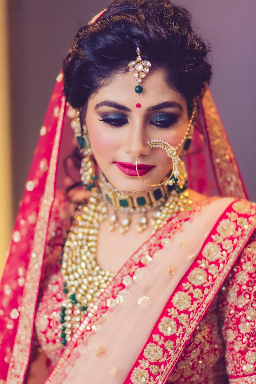 Photo of Dramatic smokey eye bridal makeup with loose bun